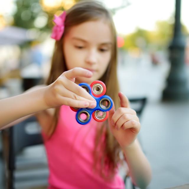 girl with calming fidget spinner